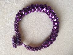 I made... First foray into cubic right angle weave. Purple pinch beads, didn't have quite enough for the full bracelet so extended it with size 06 seed beads in cubic RAW. Toggle and loop closure in size 11 seed beads. Loop in square stitch, toggle in peyote.
