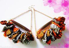 soooo cute! African Fabric earrings- Carry Me Away. $25.82, via Etsy.