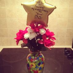 End of the year teachers gift I made. Under $15. Vase, Legos, flowers, balloon. Easy as that.