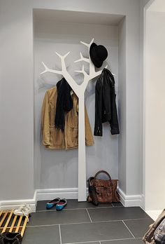 Coat tree behind front door? or in front of downstairs closet?