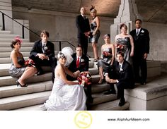 black with pewter tuxes, groom red tie, pewter dresses, red bouquets