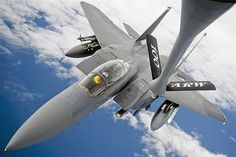 Sept. 19, 2012: An F-15E Strike Eagle receives fuel from a 100th Air Refueling Wing KC-135 Stratotanker during a training mission over the Atlantic Ocean. (© Ethan Morgan/U.S. Air Force via Reuters)