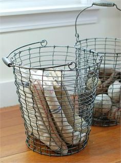The perfect storage solution for classic farmhouse style home decor, our vintage style Round Wire Baskets will keep your busy home clutter free. Stash cozy throws by the couch, create a vintage style toy bin, store vegetables or keep the mudroom organized with these sturdy wire baskets. These tall metal wire baskets, with wood handles, have a durable, industrial feel and an aged finish gives them antique rustic elegance.