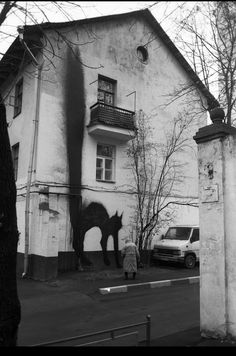Street art: looming black cat.
