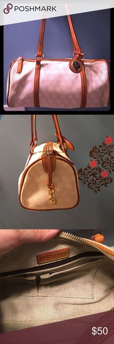 Dooney & Bourke  Barrel Purse Amazing condition Dooney & Bourke Barrel purse in cream and off white material with a beautiful honey brown leather trim. Has zipper closure plus strap inside to hold keys. As well as an extra zipper pocket in the inside. There's not a single stain or mark anywhere in or outside. Dooney & Bourke Bags Shoulder Bags