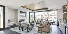 From Backsplash to Hearth, This Modern Beach House is Wrapped in Luxe Thin Marble Slabs – Beach House Decor Fireplace Hearth, Fireplace Surrounds, Modern Fireplace, Fireplaces, Fireplace Ideas, Miller Homes, Living Room Grey, Living Rooms, Family Rooms