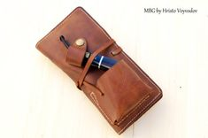 Original design craftsman Hristo Voyvodov -hand made leather pouch for pipe, tobacco and pipe tools. Compact and functional organizer pipe with 2 pockets for tobacco and 4 pocket lighter and tools. Accessories MBG by Hristo Voyvodov with traditional premium quality workmanship and