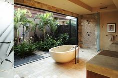 Back to Hawaii, where Willman Interiors provides a sliding glass door/wall to separate two showers - one indoors and one out, so one can alw...