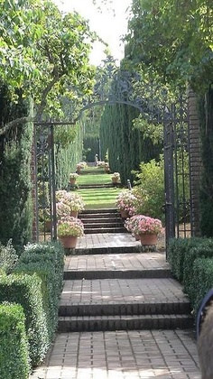 Lovely path must lead you to a lovely testing space with stone statues, table and benches, possibly water fountain...Serenity