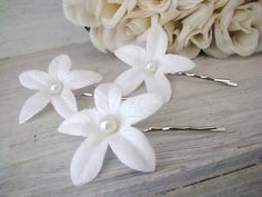 Stephanotis bobby pins from Diana M. on Etsy.  Another use for a beautiful flower.