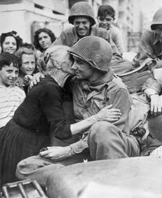An old Italian woman shows her gratitude to one of.