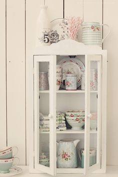 Pretty little cupboard with lovelies nicely displayed.
