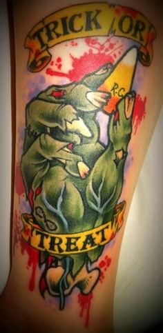 Zombie hand + Candy corn + Halloween = a tattoo that I freaking need.  So much love for everything in this tat.  <3
