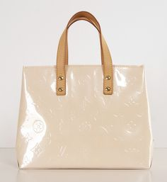 """Pale Pink Small Louis Vuitton tote- It is 9"""" at the bottom, 7"""" in height and 4"""" wide. Perfect condition."""