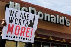McDonald's workers and supporters rally outside a McDonald's, Wednesday, April 15, 2015, in Chicago. #FightFor15