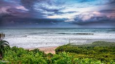 Jeffreys Bay during a storm with a color sunset clouds, South Africa | Eastern Cape, South Africa | #stockphotos #gettyimages #print #travel