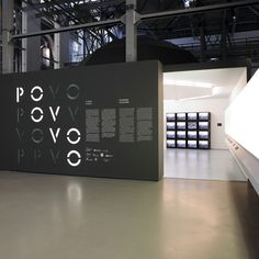 POVO Exhibition Design - Fantastic use of light/dark contrast to create an inviting exhibition title wall.