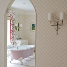 Romantic bathroom  The mix of old, new, formal and informal gives this room a flamboyant feel. The pink bathtub and floral curtains add a feminine touch.
