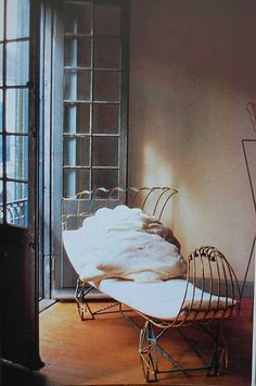 Curving sculptural design demands attention elegantly (vintage , scalloped linen pillows invite).