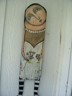 rustic lady with flower painted on old board. Love this idea.