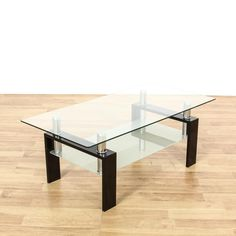 This contemporary coffee table is featured in a plastic laminate with a glossy black finish. This coffee table has shiny chrome accents, a clear glass table top and frosted glass base tier. Sleek modern piece perfect for a minimalist living room! #contemporary #tables #coffeetable #sandiegovintage #vintagefurniture