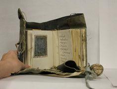 Nest of Patience by Kristin Alana Baum (Blue Oak Bindery).  A contemporary Book of Hours based on a medieval girdle book.