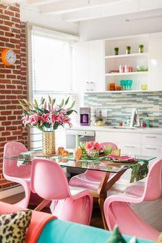 Pink Chairs, white kitchen, colorful apartment decor // House Tour: A Vibrant Urban Jungle Paradise DTLA Loft | Apartment Therapy