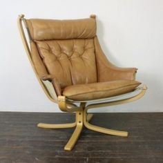 Vintage light tan leather high back winged Falcon chair designed by Sigurd Resell