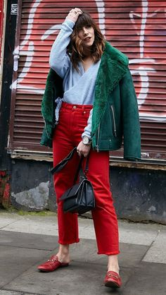 Love these vibrant red pants with cropped length, red corduroy pants with a green jacket and light blue wrap blouse, red pants