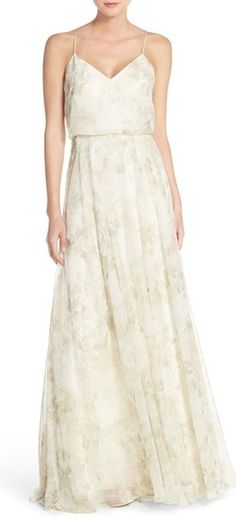 This dreamy chiffon dress is perfect for a June wedding. Swooning over the subtle floral print and delicate straps!