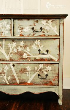 Distressed dresser with branches. Iii could so do this. And I think I will. (kind of a cool idea, not sure I love it, but cool) @Anna Totten Barker