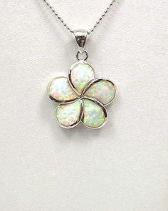 Click Here. Double your traffic. Get Vendio Gallery - Now FREE! Brand new man made Opal set in solid 925 sterling silver (not plated, not bonded) Hawaiian Plumeria flower pendant Description : - Flowe