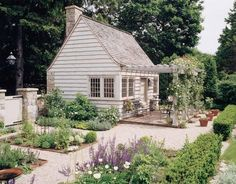 This exquisite potting shed with pergola by Douglas VanderHorn Architects even has a working chimney.