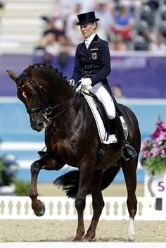 Helen Langehanenberg of Germany cometes with her horse Damon Hill, in the equestrian dressage