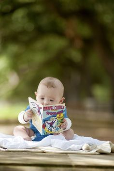 Adorable, as long as he/she gets introduced to REAL books when he/she is older. Comic books and Graphic 'Novels' are NOT are books. Cute Kids, Cute Babies, Baby Kids, Baby Pictures, Baby Photos, Little People, Little Ones, Photos Of The Week, I Love Books