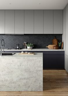 This contemporary urban kitchen has been designed using Laminex's range of decorative surfaces, including the Elemental Ash benchtop and Lava Grey + AbsoluteMatte Black cabinetry.