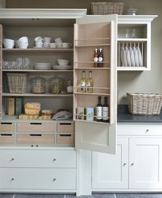 9 Beautifully Organized Kitchen Pantry Designs. This pantry cabinet is elegant and functional. I like the spice racks on the drawer insides
