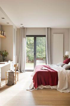 Dormitorio con una manta roja. Dormitorio con una manta roja sobre la cama_00357361