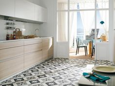 We like the large pattern tile on the floor and the modern cabinets Kitchen Tiles, Kitchen Dining, Kitchen Decor, Kitchen Cabinets, Cupboards, Kitchen Appliances, Minimal Home, Best Flooring, Modern Cabinets