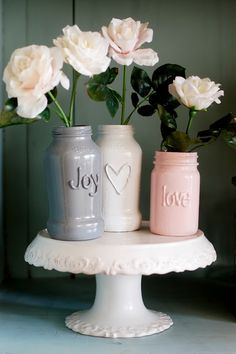 Hot glue gun words into jars and paint with bright or pastel colours