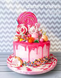 This bright pink sweetie drip cake would be the perfect birthday cake! Topped with a lot of sweets and rainbow sugar strands. Cupcakes, Cupcake Cakes, Bolo Trolls, Drippy Cakes, Candy Cakes, Candy Theme Cake, Drizzle Cake, Novelty Cakes, Cake Boss