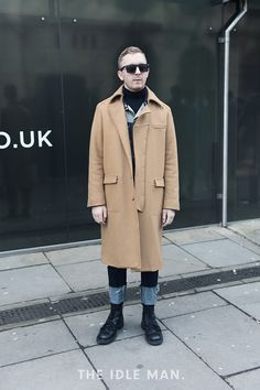 London Collections Men street style, tapered jeans paired with a roll-neck top, a classic pair of wayfarers and a camel coat | The Idle Man