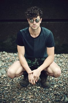 Round Black Sunglasses paired with Black Tee , Printed Shorts and one can finish this outfit by wearing Boots Curly Hair Men, Curly Hair Styles, Cool Sunglasses, Circle Sunglasses Mens, Oakley Sunglasses, Round Sunglasses, Men's Grooming, Summer Essentials, Haircuts For Men