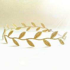 Athena is the Greek Goddess of wisdom, courage, inspiration, skill, and patron of heroic endeavor. This Grecian styled Athena Golden Leaf Halo headband embodies all these fine traits will be a perfect accent to any hair style. The elastic vanilla white finished ribbon tie allows for a perfect fit...