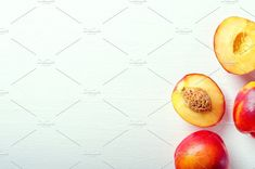 Fresh cut and whole ripe nectarines  by Mellisandra on @creativemarket