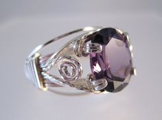 Amethyst wire wrapped prong ring in Argentium silver