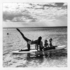 Stand up paddle board yoga with the kids  SupMommys on facebook. SupMommy will be way better than soccer mom!