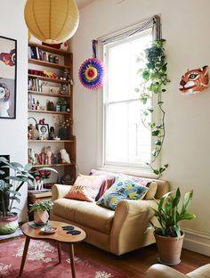 Happy boho living room, love the tiger head on the wall!
