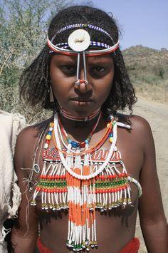 Ethiopian girl from Dorze Tribe wearing beaded breastplate