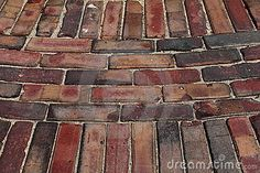 Old Red Brick Paving Stones With Grass Growing Along Royalty Free ...